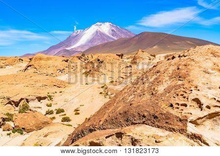 Active volcano with the smoke in Uyuni Bolivia