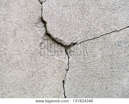 The Large cracked stone wall background texture