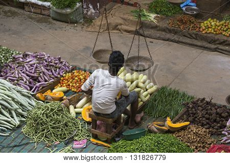 MATARA SRI LANKA - NOVEMBER 5 2014: Unidentified sellers in street market sell fresh fruits and vegetables. Many people buy fresh food on the street rather than at shops.