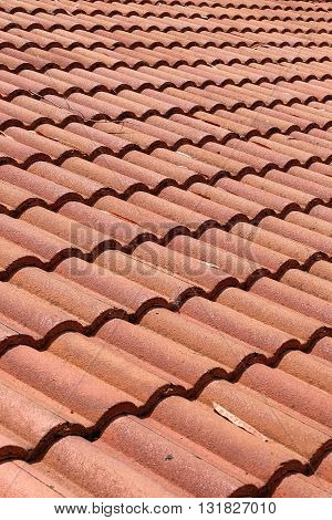Brown Tile Roof Weathered On Building Residential