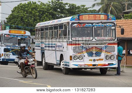 HIKKADUWA SRI LANKA - NOVEMBER 11 2014: Regular public bus from Hikkaduwa to Galle. Buses are the most widespread public transport type in Sri Lanka.