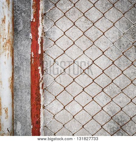 Rusty Iron Chain Wire Fence On Cement Wall Background