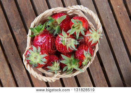 Tasty Strawberries In Basket Under Wooden Background