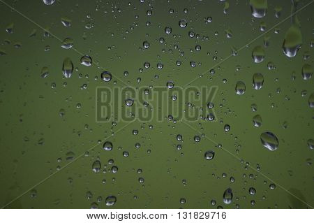 Rain drops on a window during a rainy day