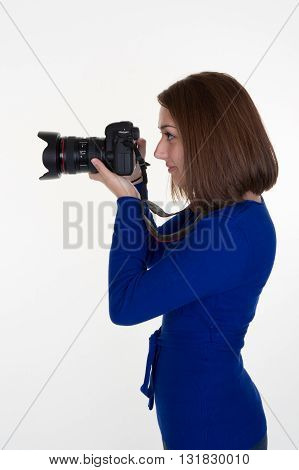 Profile Of A Female Photographer Shooting Someone