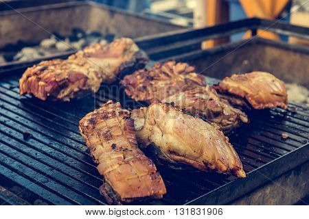 Crispy pork on barbeque. Outdoor kitchen and street food photography.