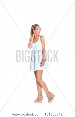 Young woman standing full length isolated on white background