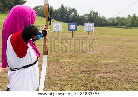 Person Practicing At Outdoor Archery Target Range