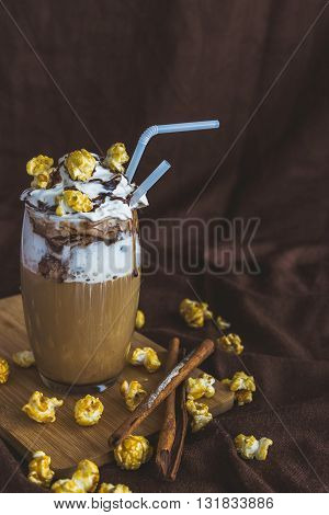Glass Of Coffee With Sour Cream, Caramel Popcorn And Chocolate