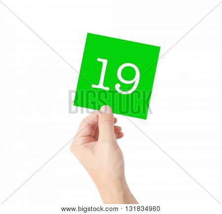 19 written on a card held by a hand