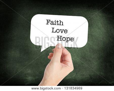 Faith, love, hope written on a speechbubble