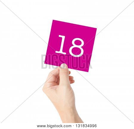 18 written on a card held by a hand