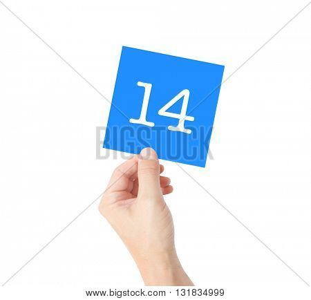 14 written on a card held by a hand