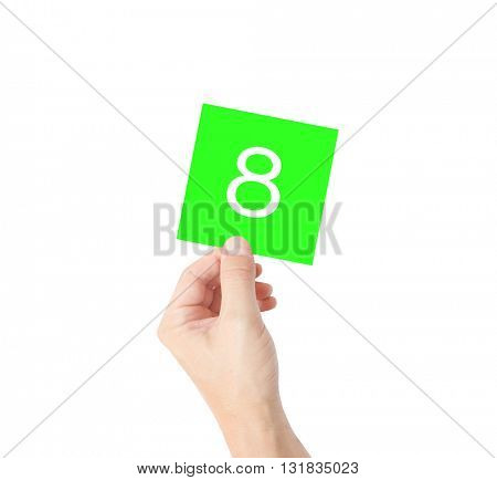 8 written on a card held by a hand