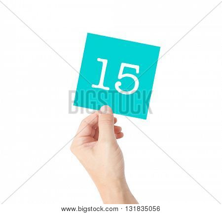 15 written on a card held by a hand