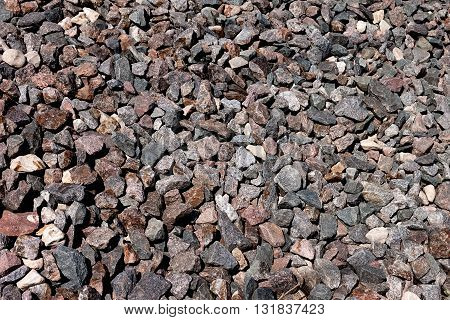 Background. Construction material. Small stones from granite of gray color