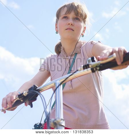Portrait of a girl with a bicycle