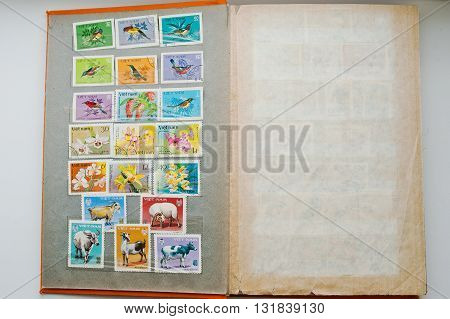Uzhgorod, Ukraine - Circa April, 2016: Collection Of Postage Stamps In Album From Vietnam Shows The