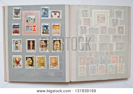 Uzhgorod, Ukraine - Circa April, 2016: Collection Of Postage Stamps In Album From Cuba And Central A