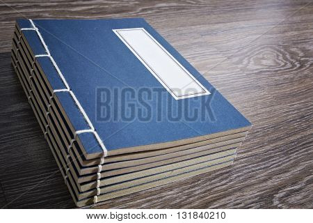 Vintage oriental Chinese style book on the wooden floor