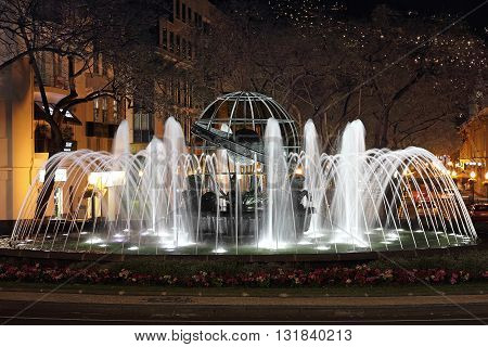 Night shot of a fountain at the Rotunda do Infante in Funchal