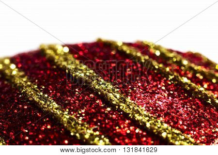 Red christmas ball with yellow stripes close up