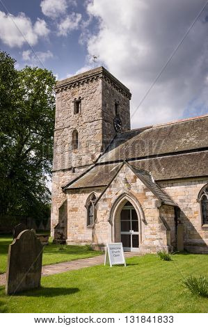 All Saints Church - Village of Hovingham North Yorkshire England the home of the Worsley family and the childhood home of the Duchess of Kent