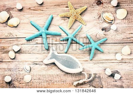 Summer holiday background with seashells and decorative fish. Copy space