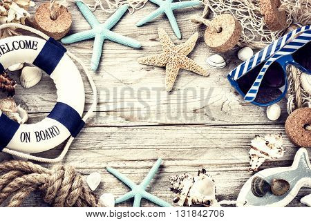 Summer holiday frame with seashells and beach accessories. Copy space