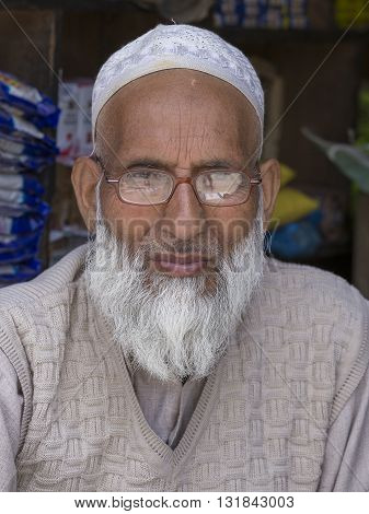SRINAGAR INDIA - JUNE 11 2015: Unidentified Indian muslim man in the market. Kashmiris are fighting for their freedom for 20 years. Kashmir became dangerous again.