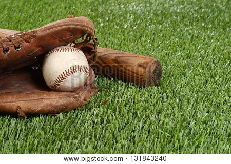 closeup baseball in glove on artificial grass