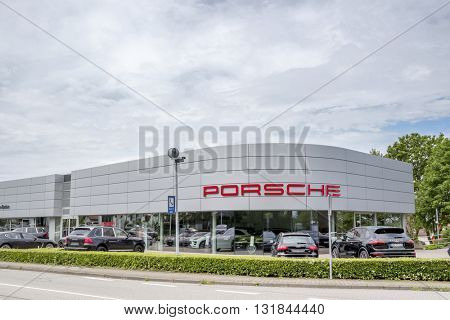 BADEN-BADEN, GERMANY - MAY 29, 2016: Office of official dealer Porsche. Porsche is a German automobile manufacturer specializing in high-performance sports cars.