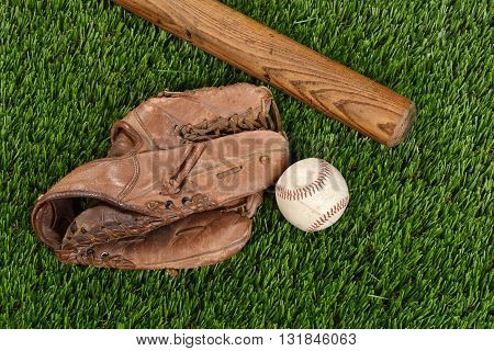 top view baseball bat glove and ball on grass
