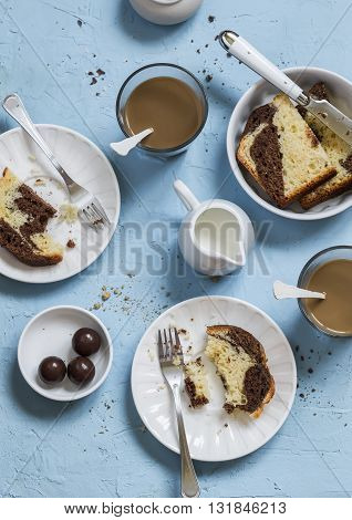 Coffee cake cream - breakfast or snack table on a blue stone background