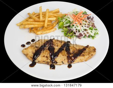 Fish fillet with french fries and salad isolated on the black background with clipping path