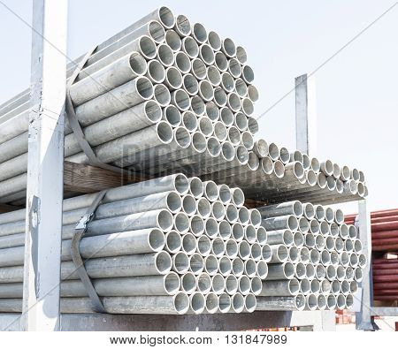Steel Pipes bunch on the rack in warehouse