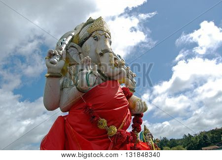 Colorful Ganesha statue on sky background at Grand Bassin, Mauritius