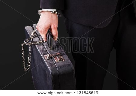 Old Suitcase Secured With Handcuffs