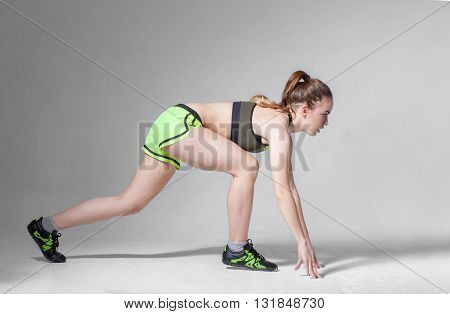 Young Sporty Woman Prepared To Start The Sprint Run Isolated