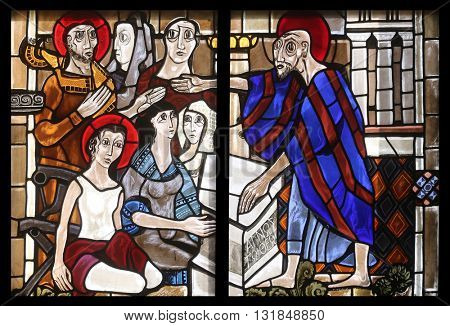 OBERSTAUFEN, GERMANY - OCTOBER 20: Scenes from the life of St. Paul, stained glass window in the parish church of St. Peter and Paul in Oberstaufen, Germany on October 20, 2014.