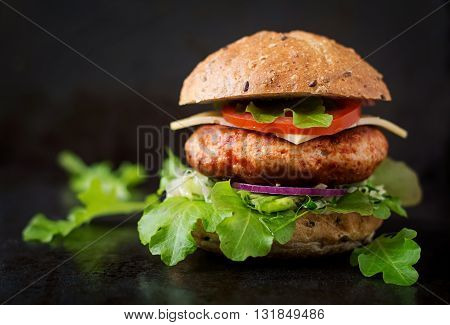 Big Sandwich - Hamburger With Juicy Chicken Burger, Cheese, Tomato, And Red Onion On Black Backgroun