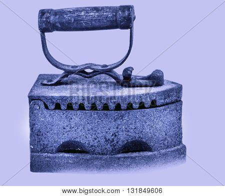 Old big iron on light blue background