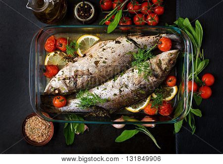 Two Baked Seabass In A Baking Dish With Spices On An Black Background. Top View