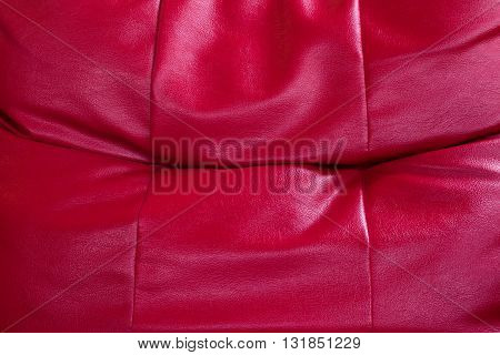 Abstract background of red sofa bed surface. Abstract background of red sofa. Abstract background. Red leather background.