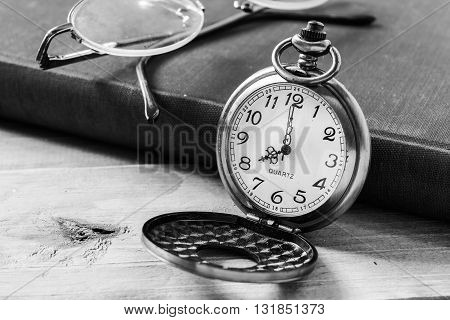 Pocket clock on books backgroundblack and white