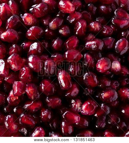 delicious pomegranate seeds in a macro photo