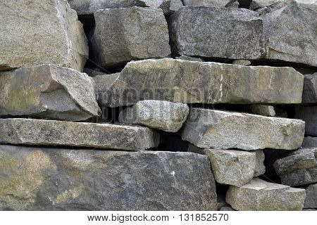 Large and small blocks of granite . Rocks made ​​by human hands .