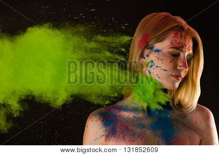 attractive blond girl in colors Holi in studio