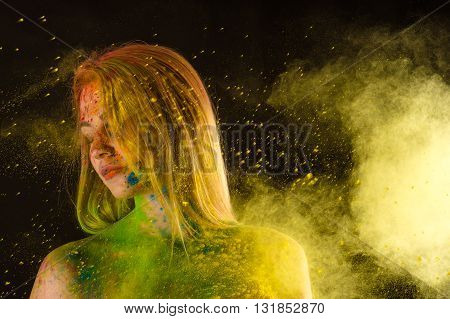 fashion blond woman in colors Holi in studio