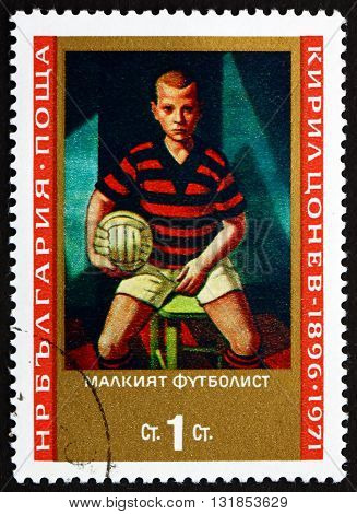 BULGARIA - CIRCA 1971: a stamp printed in the Bulgaria shows Soccer Player Painting by Kyril Zonev circa 1971